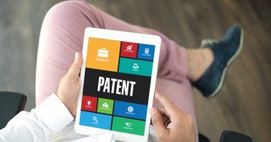 Firdapse | Lambert-Eaton News | Patents | Person holds a computer tablet displaying the word 'patent'